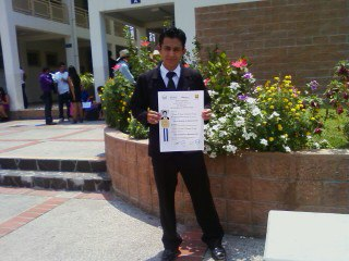 Mario with diploma of graduation