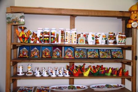 Shelf of art products in Llort's San Salvador gallery