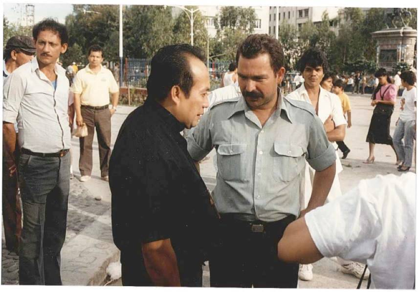 Lutheran Bishop Medardo Gomez talking with Jose in 1987.