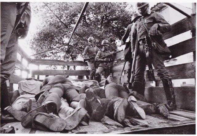 A truck bed with bodies of civilians 1980