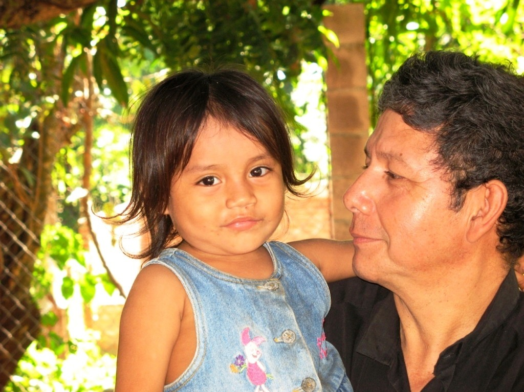 Pastor Luis provides company and affection for a parentless child.