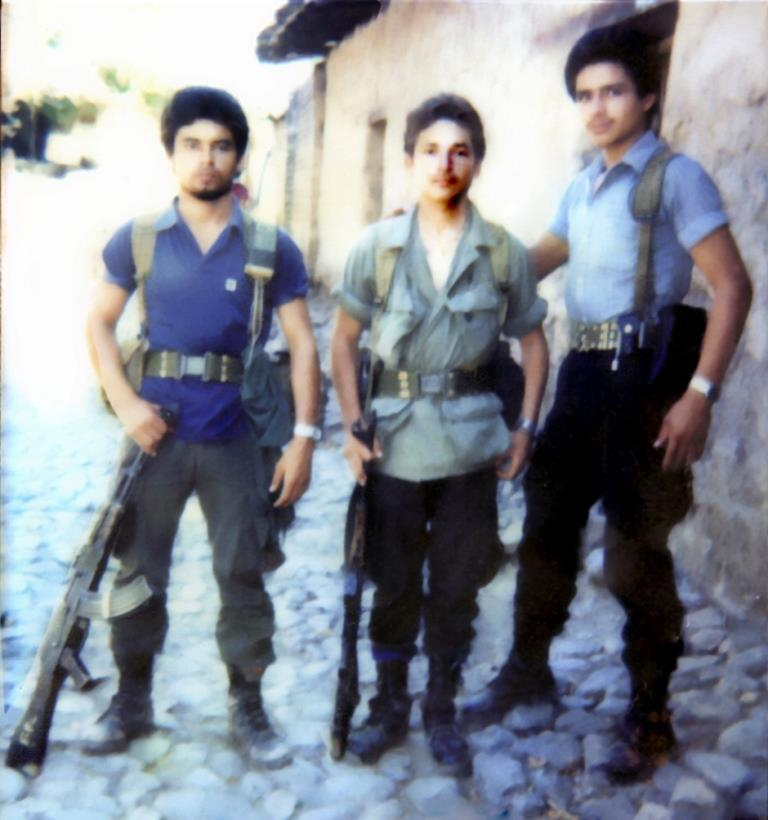 Alfredo's brother, Rigoberto, in the middle was killed during the war.