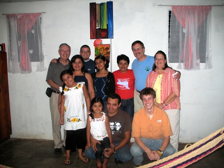 Marisol in her home with family and companion church from New Kingstown, PA.