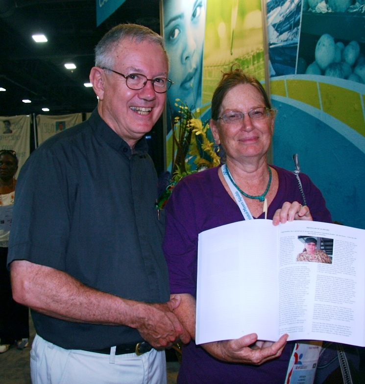 Brenda welcomes Don Seiple, Pastor Emeritus, to the Global Village at the International AIDS CONFERENCE in D.C. where a book with the story of her years of amazing service is presented.