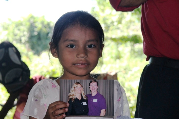People of faith reaching out to help children across the world. Pictured are Patty & Ryan Haggerty giving aid to Priscila in nearby Puente Azul